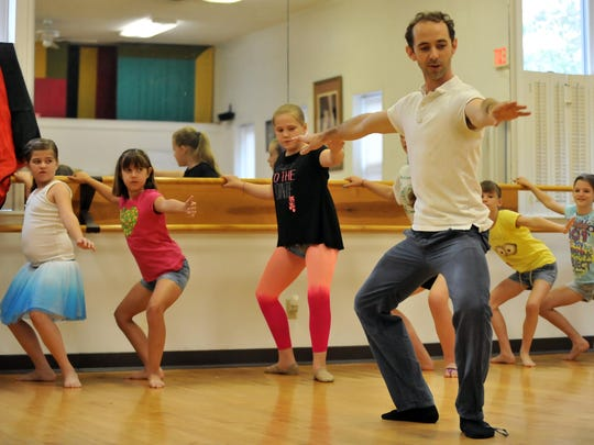 John Welker, the founder of the Atlanta Ballet Company's Wabi Sabi dancers, leads a group of children in basic ballet exercises July 23, 2014, at Baker's Studio of Dance in Lancaster. Welker and other members of the dance company taught and demonstrated ballet for children during a Lancaster Festival Major Arts for Minors workshop.