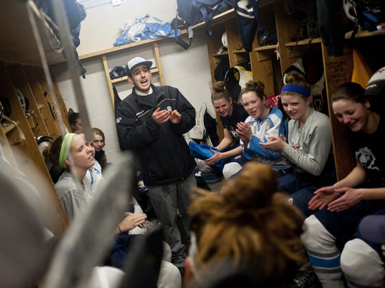 South Burlington girls hockey coach Jake Orr, center, addresses his team after the Rebels' 4-3 win over BFA-St. Albans on Feb. 7, 2014.