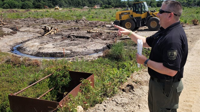 Dave Gould points to work crews at Foothills Preserve.
