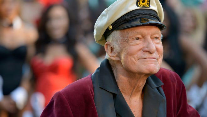 Playboy publisher Hugh Hefner sported his best silk bath robe during a public appearance in 2014.