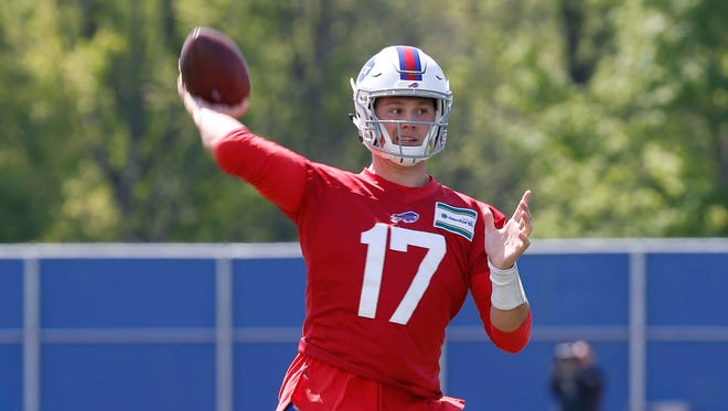 Buffalo Bills quarterback Josh Allen (17) throws a pass during OTA's at the ADPRO Sports Fieldhouse.