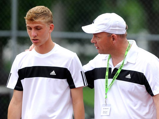 Mitchell's Beau Brown listens as his coach Pat Moller talks with him during a break from playing O'Gorman's Jake Moran during boys state tennis at McKannen Park in Sioux Falls, S.D., Saturday, May 23, 2015.