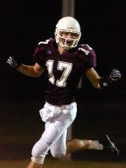 Chris LaMar celebrates a touchdown against Meade County