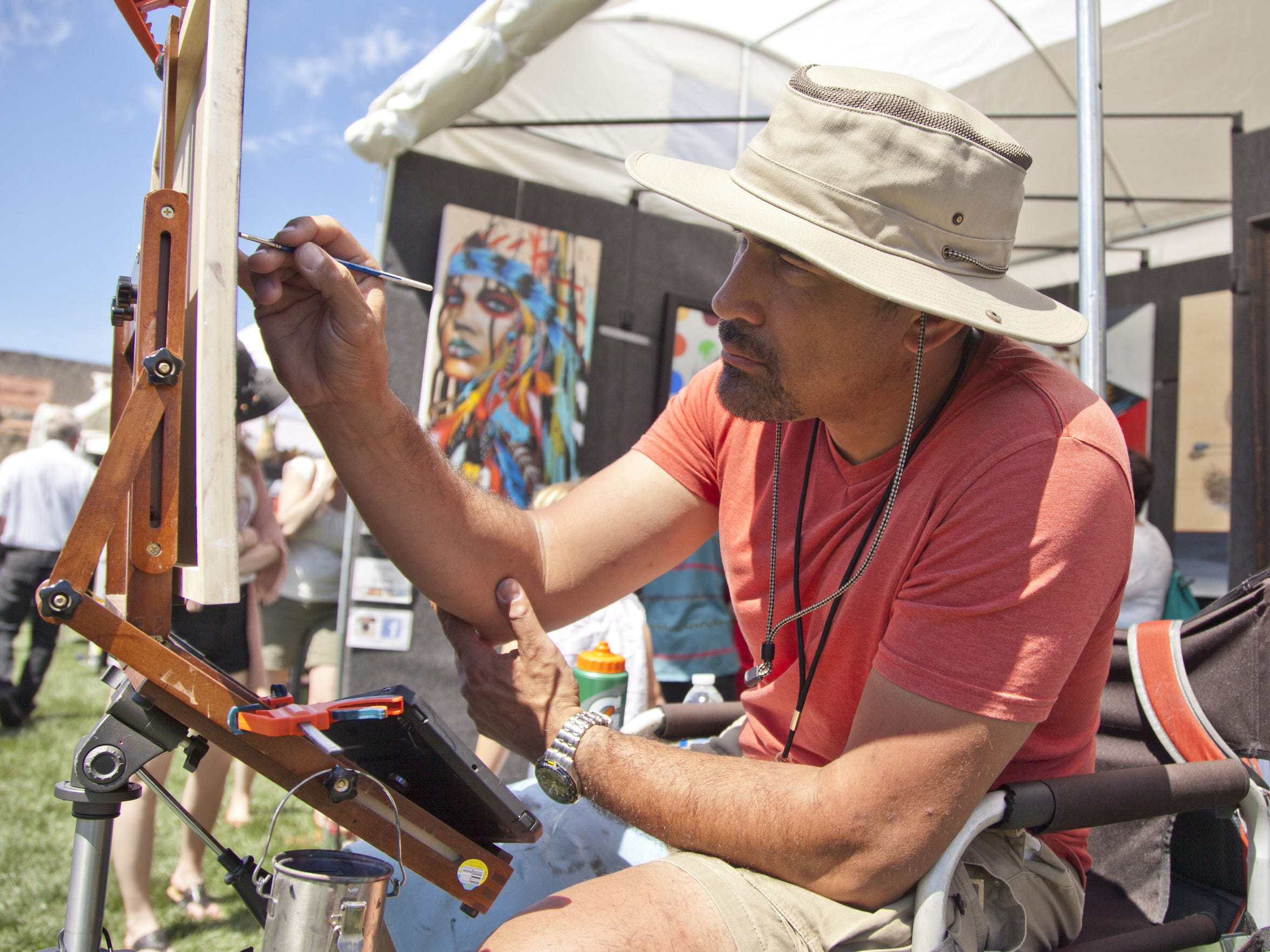 Artist Darrell Driver paints in front of his retail