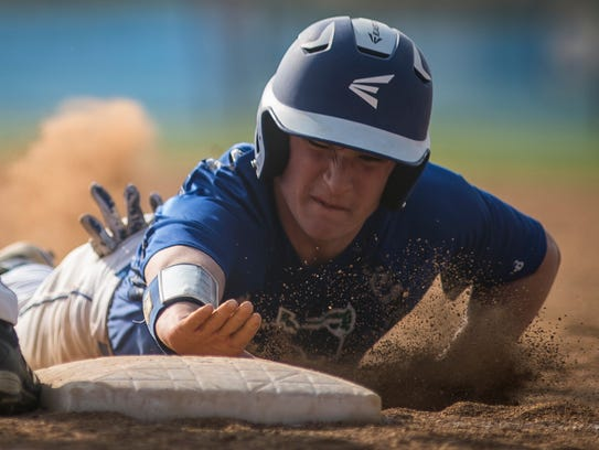 Colchester's Justin Evans hits the dirt, getting back