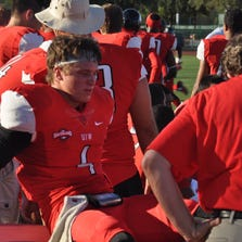 UIW sophomore quarterback Trent Brittain, who started every game for the Cardinals, has his ankle injury assessed on the sideline after he was hurt with 3:26 left in the first quarter.