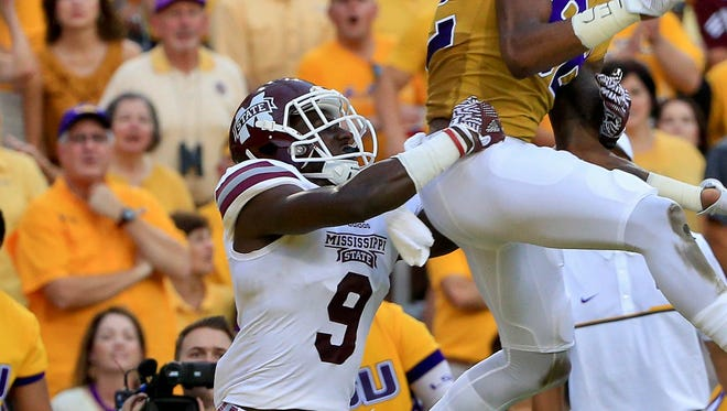 Mississippi State's Jamoral Graham tries to defend LSU wide receiver D.J. Chark in Baton Rouge last weekend.