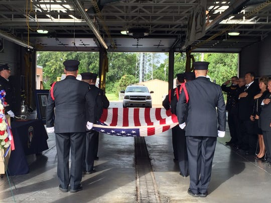 Ridge Road Fire District's honor guard carries an American flag, in honor of all killed on Sept. 11, 2001.