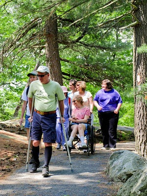 The New York-New Jersey Trail Conference's 2011 celebration of National Trails Day featured the dedication of a 0.4-mile handicapped-accessible section of the Appalachian Trail at the Bear Mountain summit. Here, families enjoy the newly accessible section.