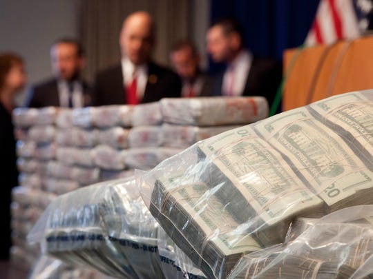Sacks of money, right, worth $2 million, and 154 pounds