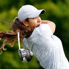 Maria Fassi, of Mexico, hits off the 10th tee during the first round of the KPMG Women's PGA Championship golf tournament, Thursday, June 20, 2019, in Chaska, Minn. (AP Photo/Charlie Neibergall)