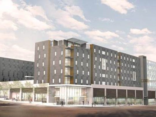 An artist's rendering of The Onyx, a residential-retail complex now under construction on the  corner of College Avenue and Macomb Street.