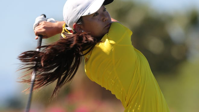 Palm Desert?s Jiyoon Jang hits a tee shot on the Mountain View Course at Desert Willow Golf Resort in Palm Desert on Tuesday. Jang shot a 37. Palm Desert's Jiyoon Jang tees off on the Mountain View course at Desert Willow Golf Resort in Palm Desert on Tuesday, September 23, 2014.