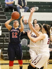 Amya Ryan of Binghamton puts up a shot as Alexus Boorse,