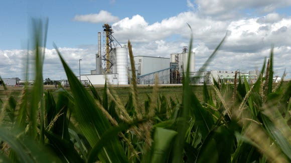 An ethanol plant stands next to a cornfield near Nevada, Iowa.
