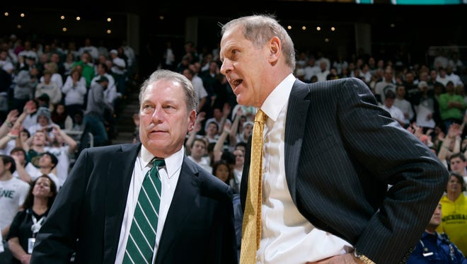 Michigan State coach Tom Izzo, left, and Michigan coach John Beilein talk before a game Feb. 1, 2015 in East Lansing. MSU won, 76-66, in overtime.