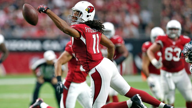 Arizona Cardinals wide receiver Larry Fitzgerald (11) misses a catch against the Philadelphia Eagles during the first half of an NFL football game, Sunday, Oct. 26, 2014, in Glendale.