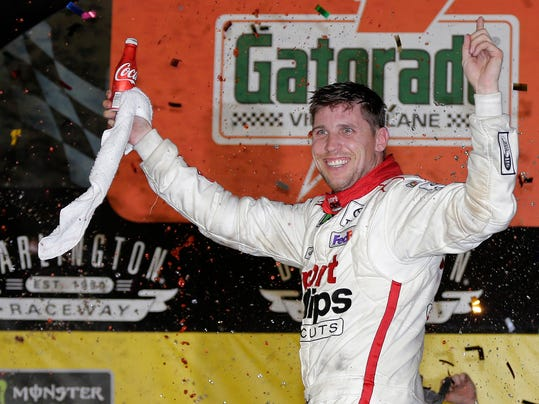 Denny Hamlin celebrates in Victory Lane after winning the NASCAR Monster Cup auto race at Darlington Raceway, Sunday, Sept. 3, 2017, in Darlington, S.C. (AP Photo/Terry Renna)