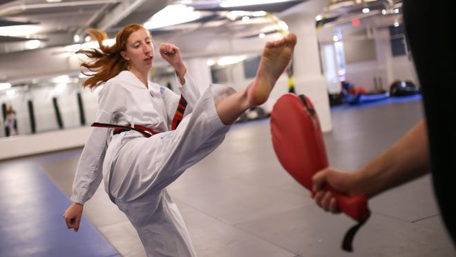 Hannah Jarrett of Canton demonstrates some of the moves she does to the Detroit Free Press with the help of Master Dan Vigil on Tuesday September 1, 2015 at Dan Vigil's Academy of Taekwondo in Northville. Vigil believes he's found a therapy for kids with ADD/ADHD like Hannah using Taekwondo to alleviate the symptoms.