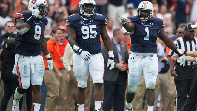 Auburn Tigers defensive tackle Montravius Adams (1) points after aiding in a sack with Auburn Tigers linebacker Cassanova McKinzy (8) during overtime of the NCAA Auburn vs. Jacksonville State on Saturday, Sept. 12, 2015, in at Jordan-Hare Stadium in Auburn, Ala.Albert Cesare / Advertiser