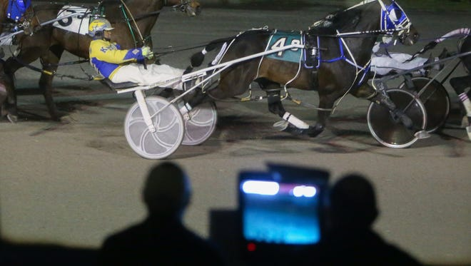 Harness racers go down the homestretch at the Northville race track on Saturday, May 14, 2016.