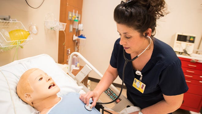 SC4 nursing student Sherry Graham works with a training dummy in the nursing simulation lab Wednesday, May 2 at the college. On Friday, Graham, who is the first recipient of the Complete Your Degree Scholarship, will graduate from the college with her Associate Degree in Nursing.