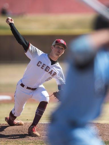 Cedar High School pitcher Bridger Bunnell throws the