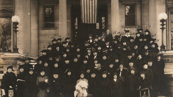 Some 80 members of Henderson's Red Cross chapter brave a snowy day to be photographed on the steps of the Henderson library during World War I.