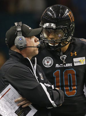 Rattlers' Kevin Guy talks to quarterback Nick Davila during a game against the Storm at Talking Stick Resort Arena on April 16, 2016 in Phoenix, Ariz.