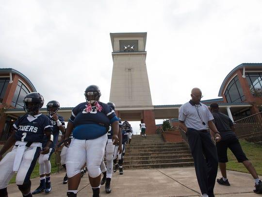 Calhoun High School coach Ervin Starr, right, walks