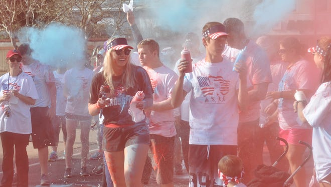 Pineville High School student Noel Lee (middle) chose to put on a Race for the Red White and Blue Saturday morning to benefit disabled veterans as her senior project.