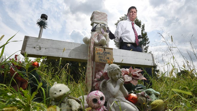 Muskingum County Sheriff's Office Detective Todd Mahle stands at a memorial near the site where Celeste Fronsman was found, burnt and barely alive, in 2012.