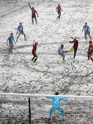 Minnesota United midfielder Johan Venegas (11) and Atlanta United defender Leandro Gonzalez (5) vie for the ball in the first half of an MLS soccer game Sunday, March 12, 2017, in Minneapolis, Minn.