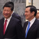 Taiwanese President Ma Ying Jeou, right, and Chinese President Xi Jinping in Singapore on Nov. 7, 2015.