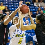 Delaware's Makeda Nicholas puts up a shot over Towson's Raven Bankston in the first half of Delaware's 69-64 overtime win over Towson University at the Bob Carpenter Center in Newark on Sunday.