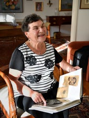 Holocaust survivor Frances Cutler Hahn of Nashville looks through a photo album as she remembers being a little girl hiding among other families while the Nazis killed her mom during WWII. Friday Oct. 6, 2017, in Nashville, TN