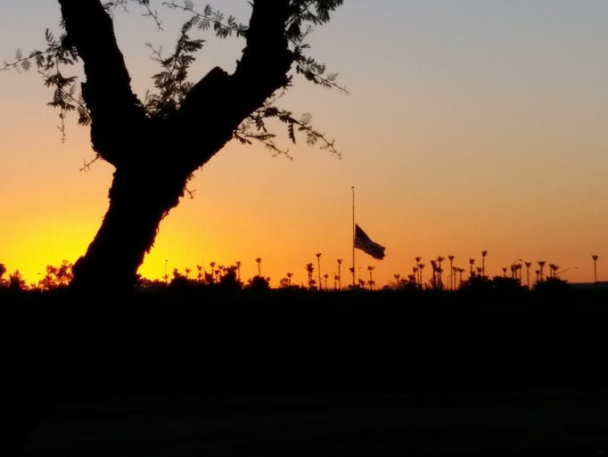 Connie Gannon photographed a flag lowered at sunset