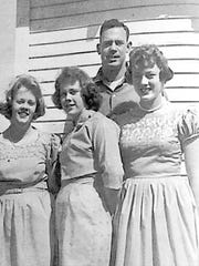 Teenagers Jane, Judy and Joan Grant with their brother, L.B.