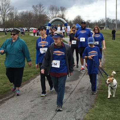 Participants walk in the Get Your Rear in Gear 5K last