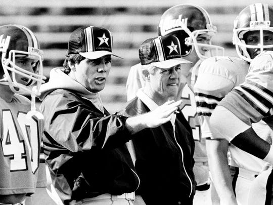 Dec. 27, 1982: Vanderbilt offensive coordinator Watson Brown, second from left, and coach George MacIntyre send the team through preparations for the New Year's Eve Hall of Fame bowl game against Air Force in Birmingham, Ala.