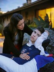 Lorena Martinez talks to her son Andrew Ochoa at his