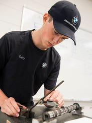 BMW Scholar James Curry, 19, of Greenville, tests a