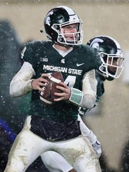 Brian Lewerke of the Michigan State Spartans throws