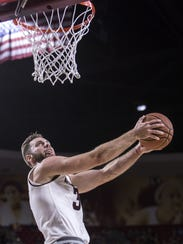 ASU's Mickey Mitchell dunks the ball against Longwood