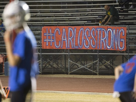 Students start to fill the stands behind a banner in memory of Carlos Sanchez at Moon Valley High School in Phoenix, Ariz. on October 27, 2017.