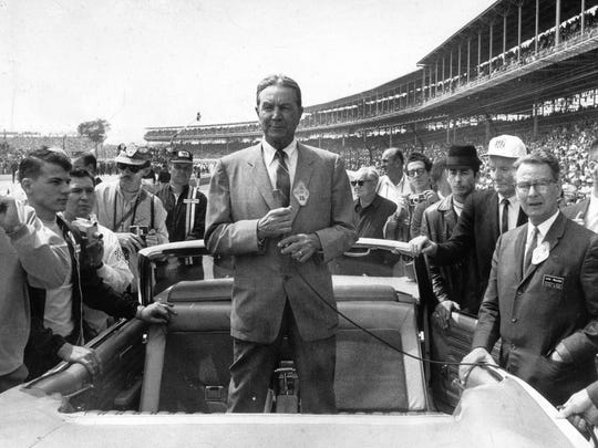 """Speedway owner Tony Hulman prepares to give the command, """"Gentlemen, start your engines"""" from the back of the pace car before the start of the race. He took over the duty of giving the command in 1956 from the late Wilbur Shaw, the man who had talked him into buying the Speedway after World War II."""