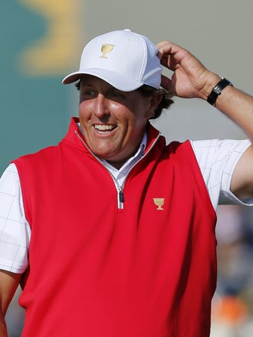 Phil Mickelson reacts to his putt on the 17th green