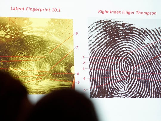 Prosecutors show photographs of a fingerprint found on a motorcycle helmet during the murder and arson trial of Patrick Thompson on Tuesday, Oct. 2, 2018, at the Monroe County Courthouse in Albia.