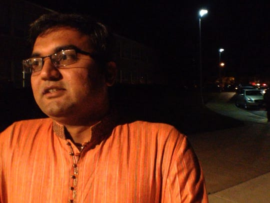 Mehul Aghera sums up the meaning and importance of the Garba, a Hindu religious festival, before joining hundreds of celebrants at Christiana High School near Newark. Aghera, a businessman, lives just north of the Delaware line off U.S. 202.