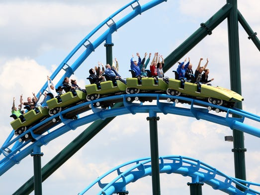 Patrons ride the Lightning Run roller coaster at Kentucky Kingdom in Louisville. The park is scheduled to reopen May 24, Memorial Day Weekend. May 17, 2014.